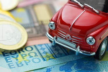 A red car on Euro banknotes